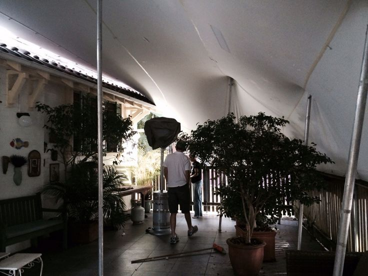 Private celebration on a balcony with a silver/white freeform marquee, a great privacy screen!!