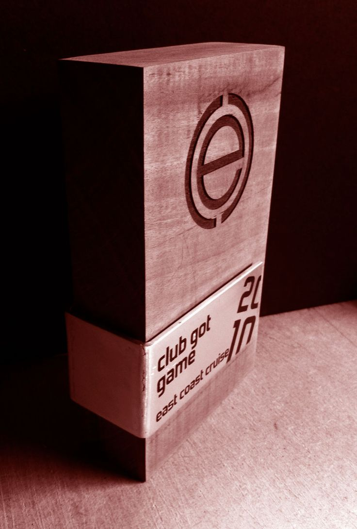 (e) 2010 Trophy - Reclaimed ironbark railway sleeper, laser etched logo, aluminium plaque with painted details.