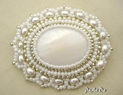 cabachon with pearls among the seed beads