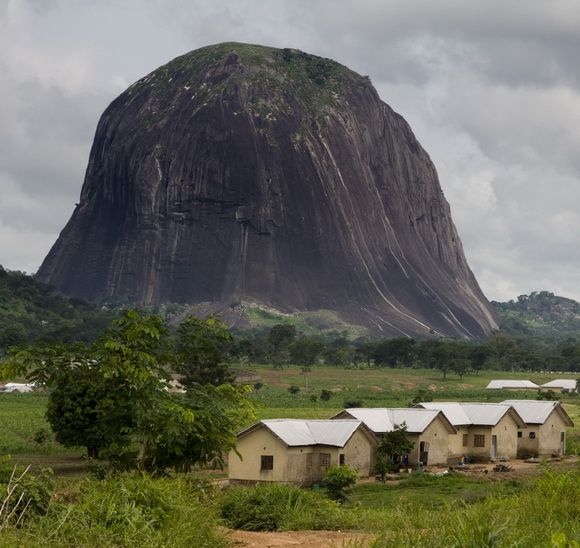 Zuma Rock is a large monolith located in Niger State, Nigeria. It is just north of Nigerias capital Abuja, along the main road from Abuja to Kaduna, and is sometimes referred to as Gateway to Abuja. - http://www.theworldgeography.com/2012/12/plugs-and-monoliths.html