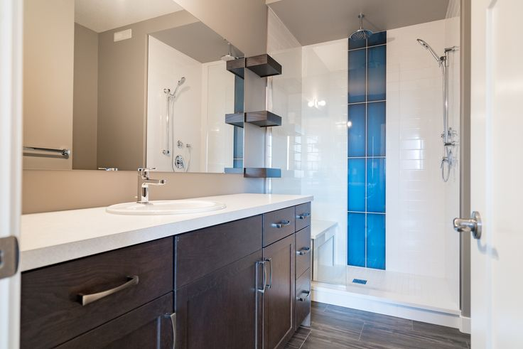 En-suite bathroom #blue #tile #floatingshelves