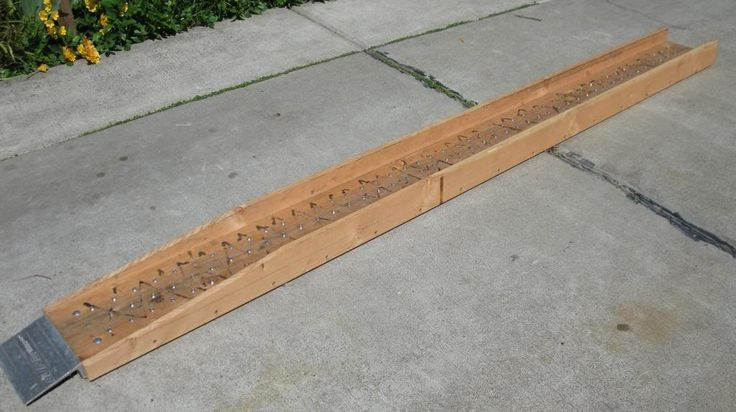 Motorcycle Ramp by DaBinChe -- Homemade motorcycle ramp constructed from 2x8s, 1x4s, an off-the-shelf aluminum flange, and Allen screws. http://www.homemadetools.net/homemade-motorcycle-ramp-2