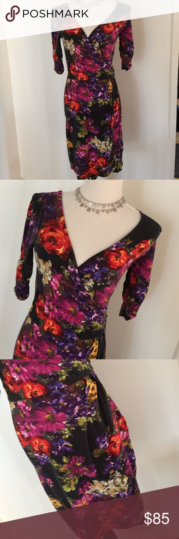 THREEDOTS STUNNING FLORAL DRESS EUC! Vibrant floral pattern on this v-neck dress with 3/4 rouched sleeves. Photos un-enhanced. Waist is rouched for figure flattering look. This is a stunner! 96% viscose 4% spandex. Machine wash cold Line dry. Easy maintenance. Make a statement! Any questions please ask! ✅OFFERS ACCEPTED. Thanks for browsing! Marian Three Dots Dresses