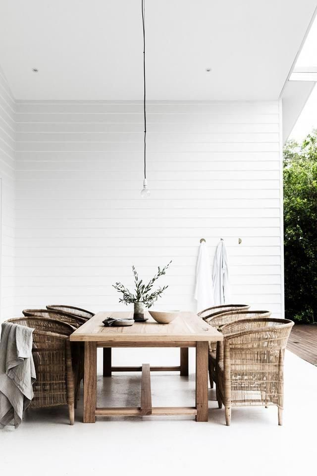 Absolutely Stunning All White Patio Situation With Woven Chairs