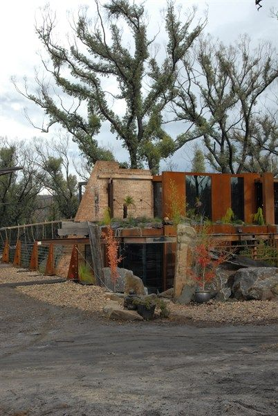 This house was rebuilt after the Black Saturday bushfires, look at the leaves re-growing on the trees. Gorgeous. And love the mix of materials used.