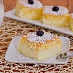 Magic Cake~~Southern Mama~~ via Living the country life on Facebook..    Ingredients:  •4 eggs (separate yolks from whites) at room temperature  •1 tbsp water  •150 g (5.3 oz or 1/2 cup plus 2 tbsp) sugar  •125 g (1 stick) butter, melted  •115 g (4 oz or 3/4 cup) of flour  •500 ml (2 cups) milk lukewarm  •powdered sugar for dusting cake