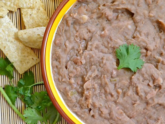 """(NOT) REFRIED BEANS   They have an incredible, complex flavor thanks to the jalapeno, chili, and other spices... and they're completely GUILT FREE....You deserve to wear a little gold star pin that says """"Winner!"""" on it just for eating these beans. Beans are full of fiber, protein, and antioxidants. 1 lb. dry pinto beans   1 medium onion  1 medium jalapeno   1 Tbsp minced garlic   1 tsp cumin   1/2 tsp chili powder   10-15 cranks cracked black pepper   1 Tbsp salt   6 cups water"""