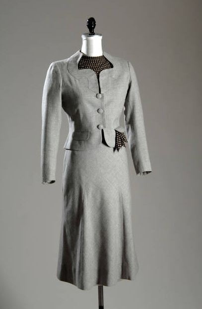 """Ensemble, Mainbocher (1891-1976), France: 1937, wool flannel and printed silk. """"Mainbocher was born in Chicago and later became the first of only two Americans allowed into the elite circle of Parisian haute couturiers. The crisply tailored lines of this suit are very similar to the silhouette of Mainbocher's design for the uniforms for the Girl Scouts of America as well as the Red Cross and the Navy WAVES of World War II."""""""