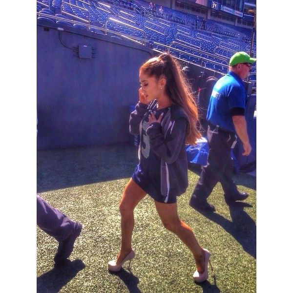 Ariana Grande performing the National Anthem at the Seattle Seahawks... ❤ liked on Polyvore