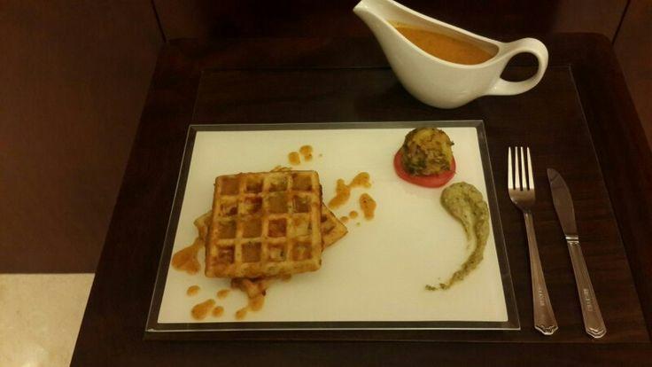 Waffle uttapa with sambar syrup & roasted raw tomato chutney and a dollap of potato curry...