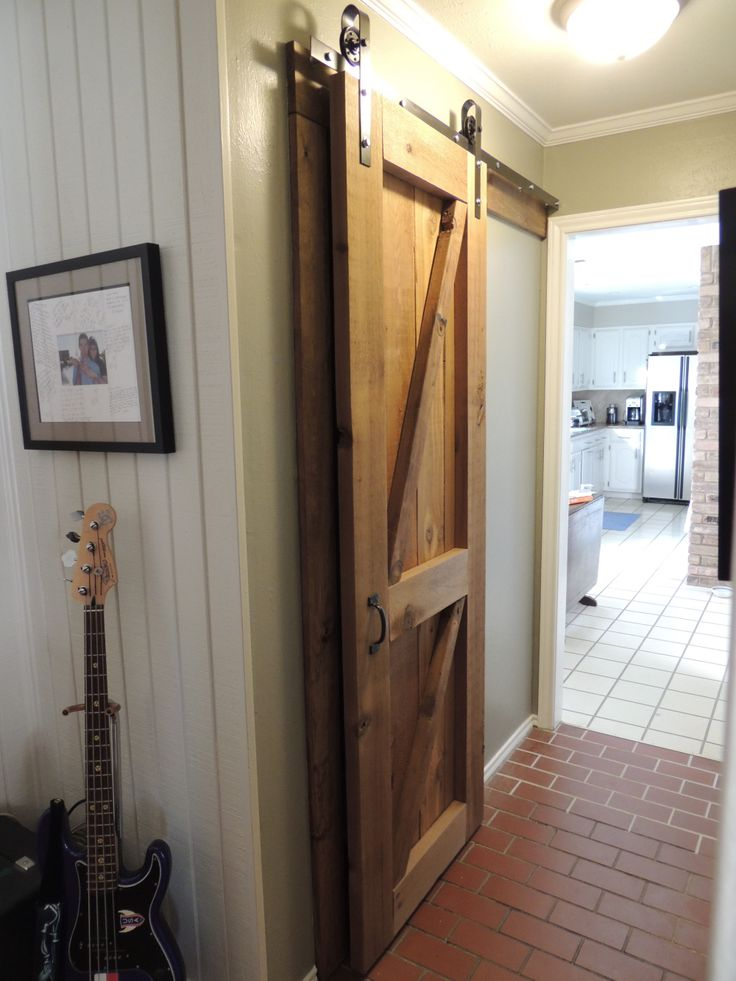 Barn Door Hardware DIY (Hardware made for about $65) - Found pulley hardware on amazon.