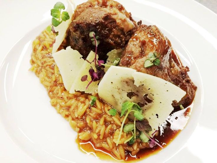 Braised beef cheeks in vintage red wine, cinnamon and orange with orzo and gruyere.