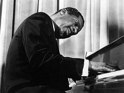 Revered American jazz piano virtuoso and composer Erroll Garner, known for his swing playing and ballads.