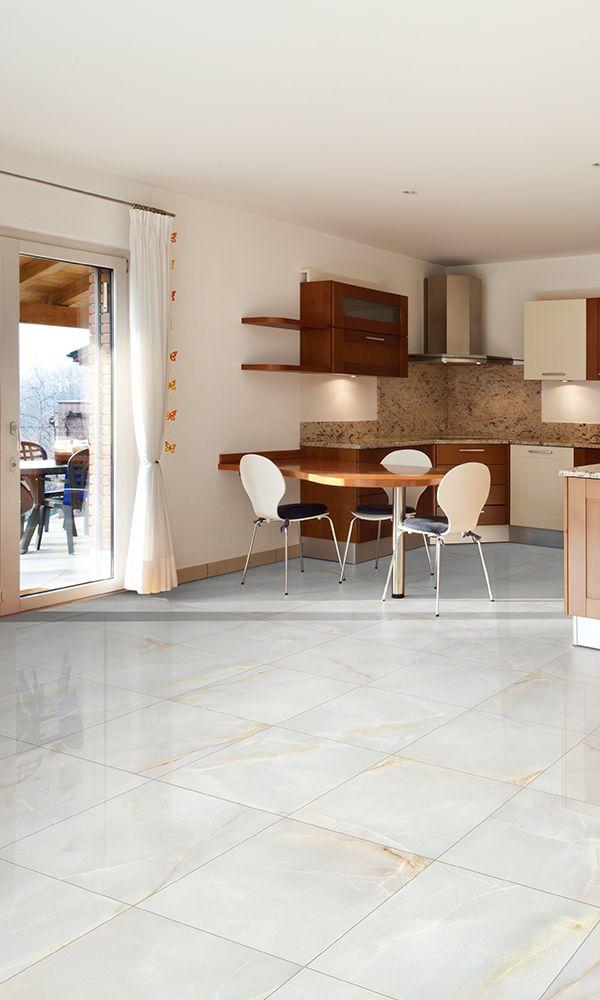 Piso blanco cerámico para interiores. Cocina en tonos claros da más iluminación a tu espacio.