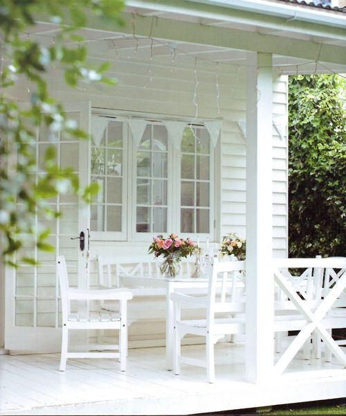 All white, romantic-style porch.
