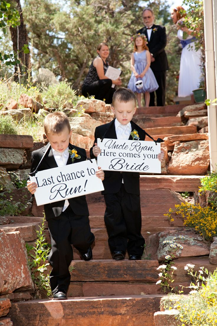 Cute Signs For The Ring Bearers To Walk Down Aisle With