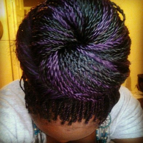 black & purple senegalese twists donut bun  <3 this color combo ((I LOVe purple steaks in my hair....got a purple braid right now :))