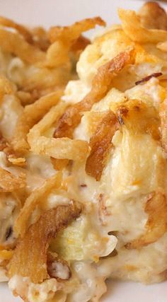 French Onion Chicken Casserole ~ It's topped off with those delicious french fried onions and filled with all sorts of goodness like chicken, cheese, sour cream, mayo and almonds... It is DELICIOUS!