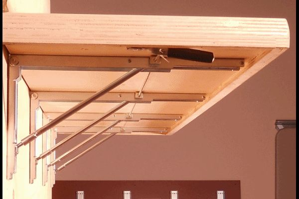 Multiple Wall Mounted Folding Bracket Supporting A Bench