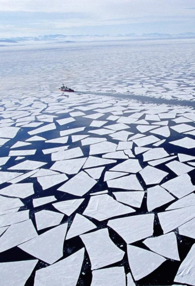 An ice breaker plows through a ice field. #antarctica #climate #warming http://jgfollansbee.com