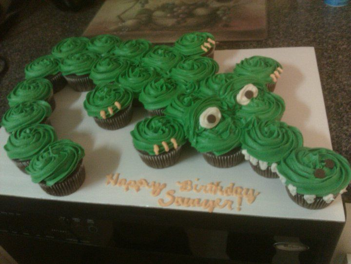 Alligator Cupcake Cake - My son wanted an Alligator cake to take to daycare for his 3rd birthday, so I made this one out of cupcakes. They are chocolate chip cupcakes topped with marshmallow buttercream.