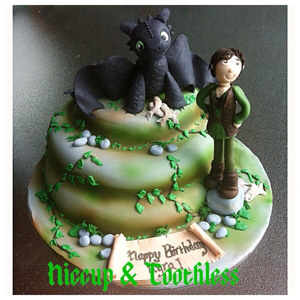 A cake for a 'how to tame your dragon' fan ....love my little toothless sugar model!