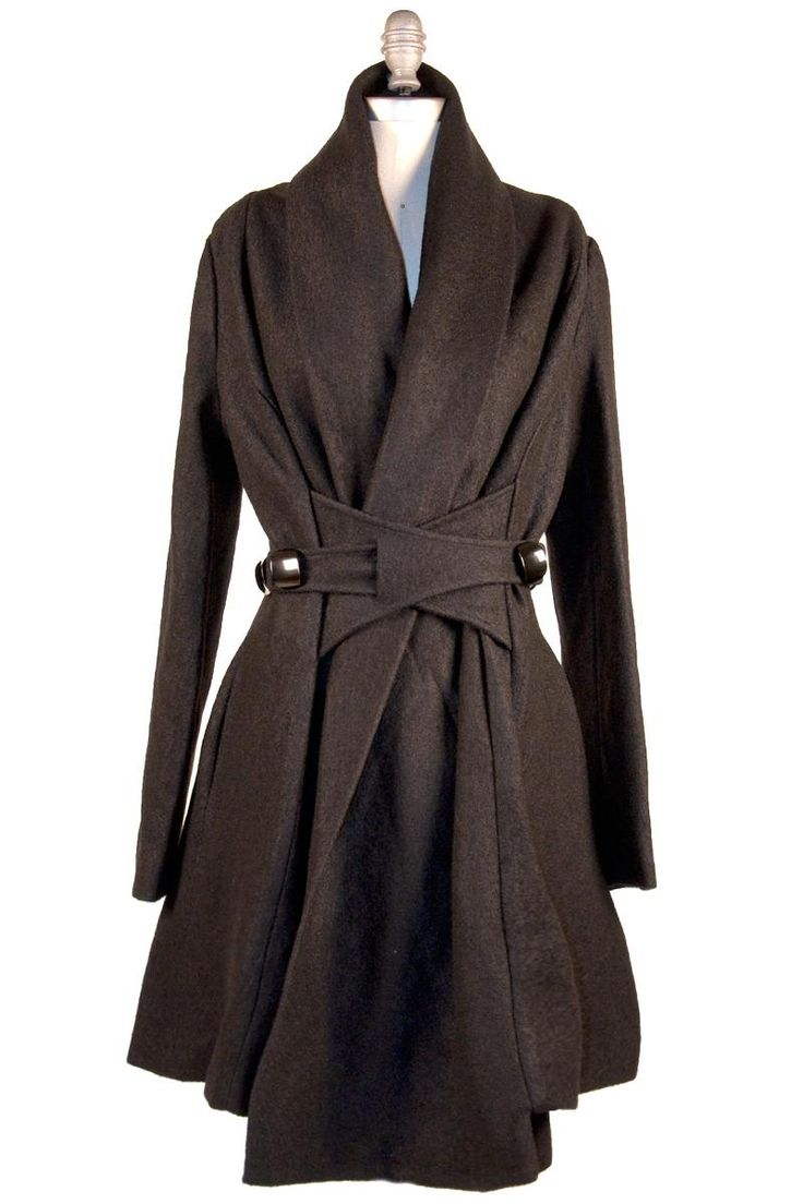 The Thousand Ways Coat  $142.99    With a seemingly-endless number of folds, closures, and buttons, you can wear this coat in a symmetrical kimono style, cinch it to one side, wear the collar wide and warm, or tuck and fold it into a more slender silhouette.     The lining on this garment is truly special as well. Made of silk, the colorful print features images of Japan in Spring with geishas, cherry blossoms, and colorful kimonos splashed on a black background. The coat and pockets are…