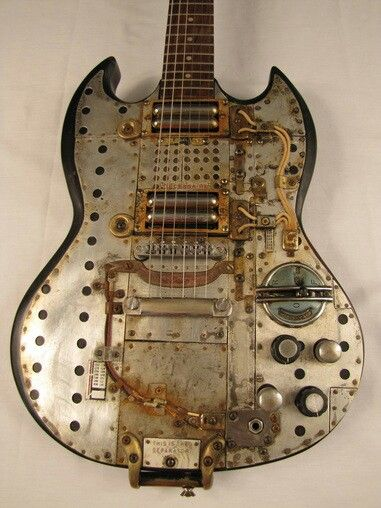 I think I've found a direction to go with my SG rebuild ...LOL! Steampunk custom guitar