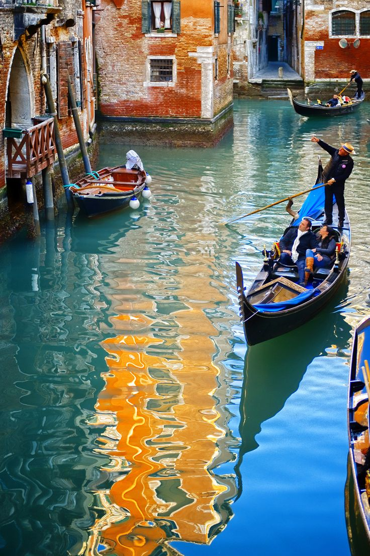 Canal in Venice, Italy I hope to be able to ride on one of these!!