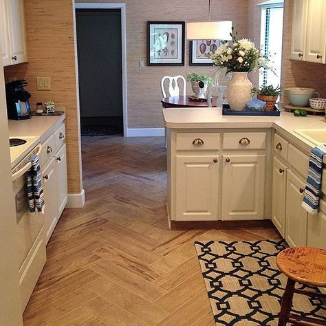 """Sharing my galley kitchen, (it's sized appropriately to my cooking talent--lol) for #EVpicks' week of sharing our kitchens. We knew a complete reno was not in the budget so we carefully chose the updates that would give us the most impact and turn a """"cold space"""" cozy. We removed the fluorescent Lumadome lighting and raised the ceiling, updated the space with recessed lights and a drum pendant and changed from dated '80s tile to this wood-look tile set in a herringbone pattern. We loved the…"""