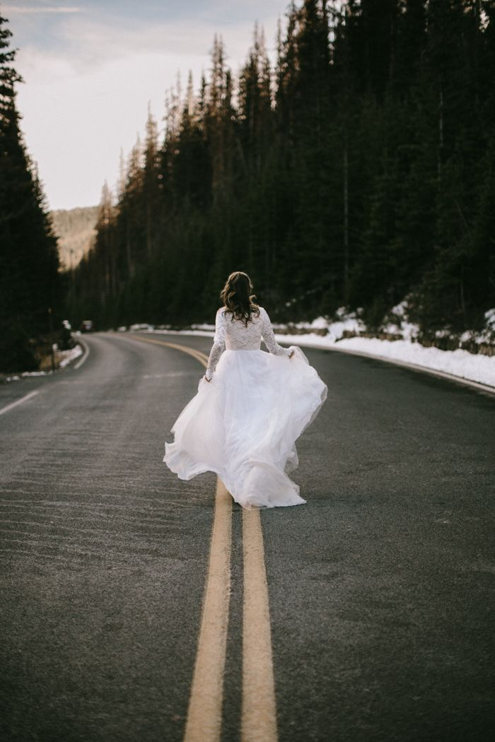 This mountain bride is rocking her Wear Your Love wedding dress  | Image by  From The Daisies