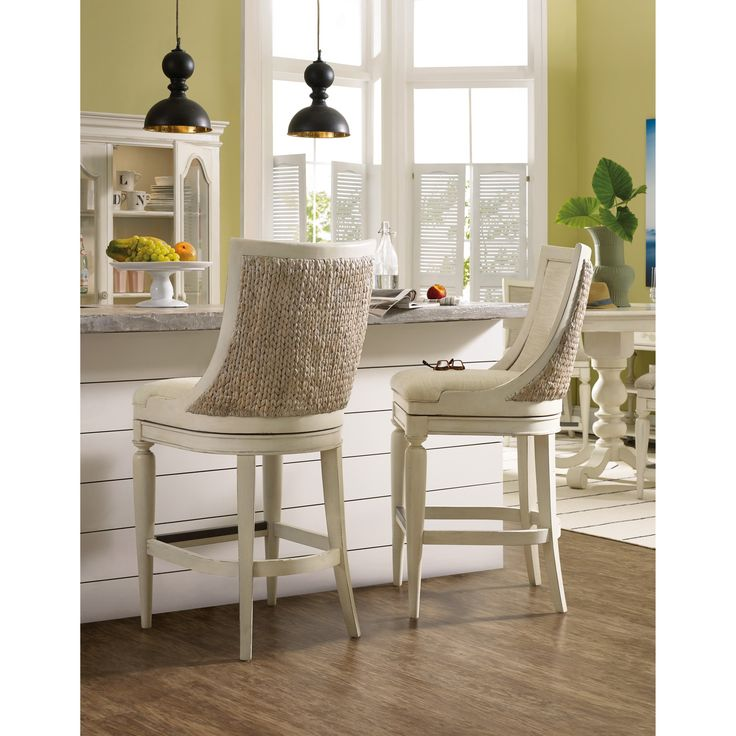 Enjoy your early morning cup of coffee as if you were on a sandy beach with this coastal-inspired swivel barstool. The stool offers a swivel seat so that you can move about with ease. The Birds Eye linen upholstery promises comfort, while a woven sea grass back exterior highlights casual coastal style. Use this barstool in your eat-in kitchen counter or at your home bar for beach chic style.