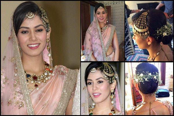 Mira's post-wedding attire had traces of European royalty. She definitely carried it well with a statement neckpiece made of coloured gemstones, a traditional half sun maang tikka and a jhoomar. Her lehenga was with a backless choli.