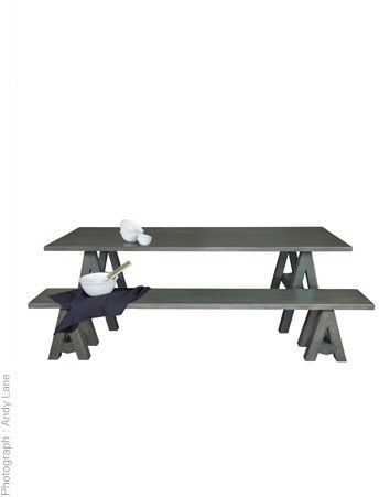 Solid oak table and bench. Finished in charcoal or white wash. Handcrafted to order.