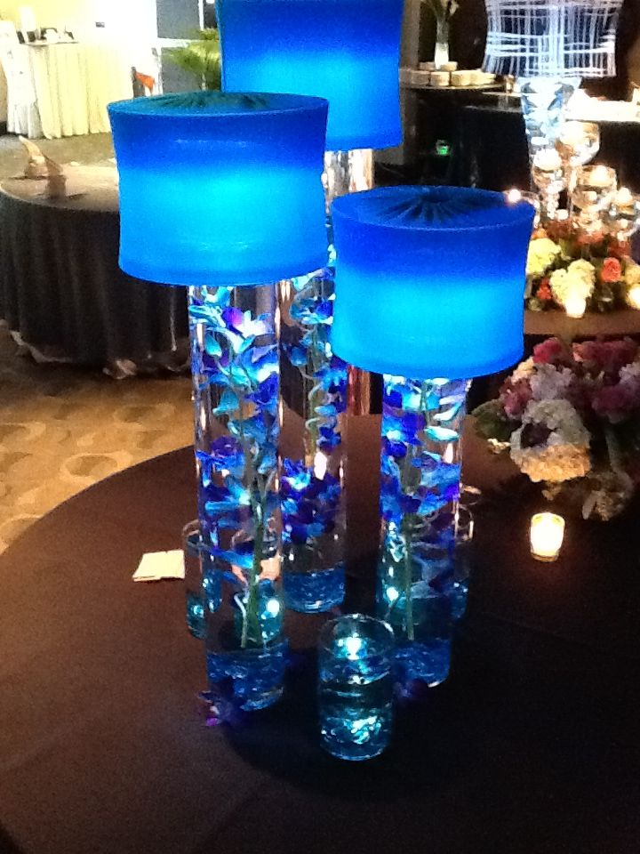 Trio Of Water Filled Cylinder Vases With Orchid And Topped With Turquoise Shades Lighted