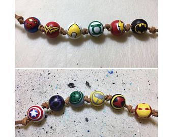 Justice League wooden bead necklace. Awesome for avid reader, comic book lover, great gift and totally unique. My kids would love these. #reading #superhero #fiction #ad #books #movie