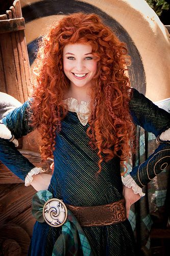 Gotta be the best Merida! Disney costume with patterned fabric, belt and brooch with plaid fabric detail.