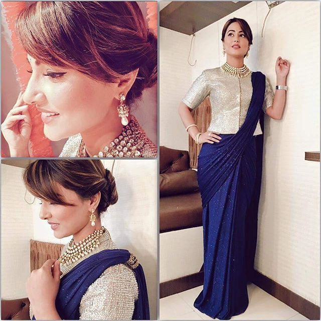 Bored of draping saree in the usual style? Take cues from television star Hina Khan. She looks stunning in a deep navy blue ready-to-wear #saree with subtle, scattered silver accents – paired with a long metallic silver hued #choli. The gorgeous jewels she uses to adorn her swan neck have us floored!