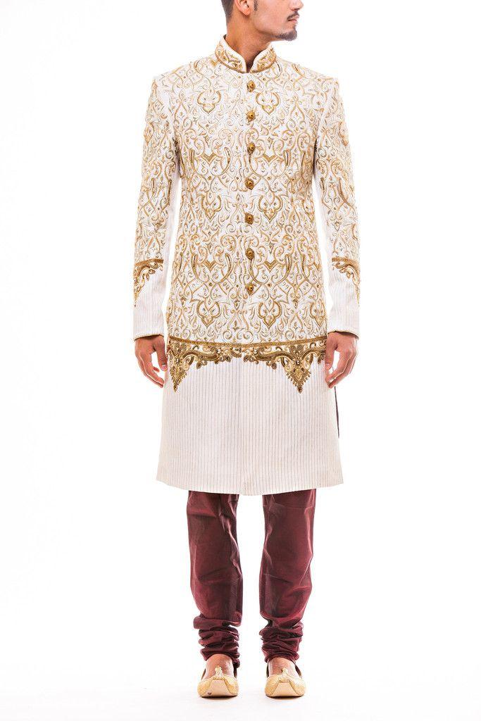 Stunning Gold Kasab and Zari work Wedding Sherwani on White Tussar Silk paired with Maroon Churidaar