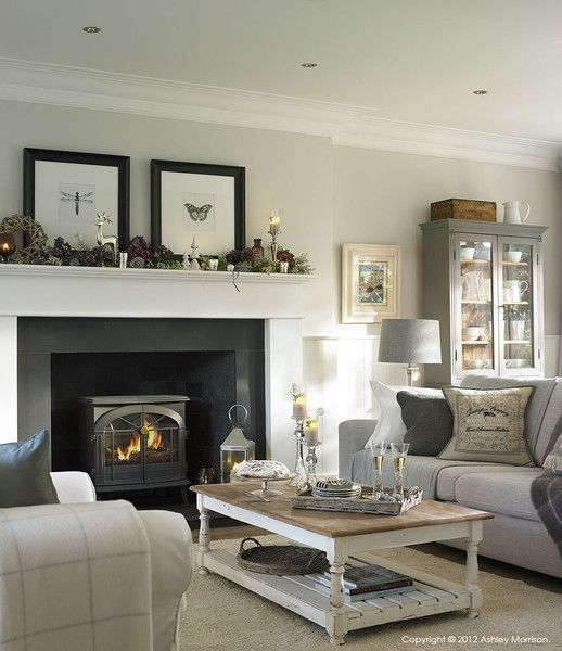 Christmas mantle filled with fresh greenery and berries
