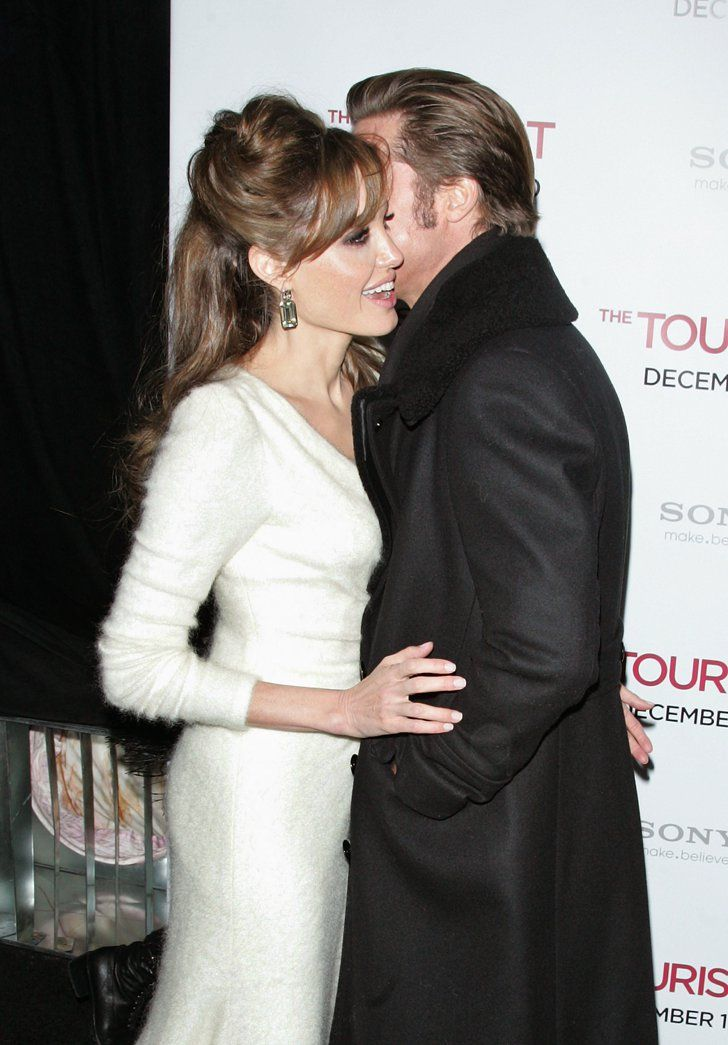 Pin for Later: 31 Times Brad Pitt and Angelina Jolie Showed Their Love For Each Other (and the Cameras!)  Brad brought Angelina in for a kiss on the cheek at the NYC premiere of The Tourist in December 2010.