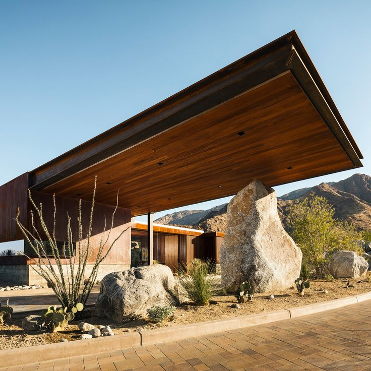 Studio AR+D has built a guardhouse for a new neighbourhood in Palm Springs, with cantilevers that form a roof over a parking spot and large boulder.