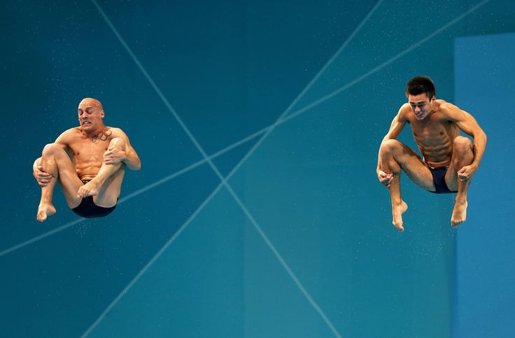Nicholas Robinson-Baker and Chris Mears of Great Britain compete in the Men's Synchronised 3m Springboard final on Day 5