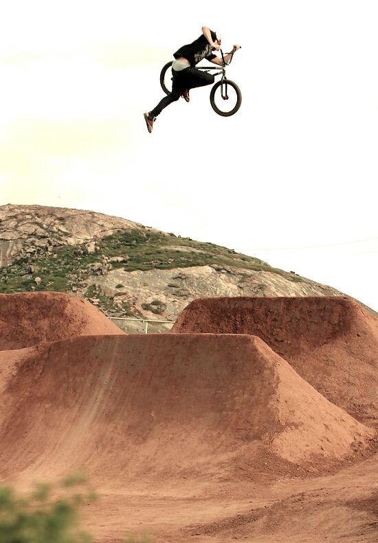 Great air! BMX - Dirt Park  Kris Fox at Dacompound stretching out this Nac Nac