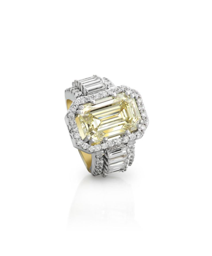 Beautiful handmade designer ring set with yellow diamond as the main stone- Jenna Clifford