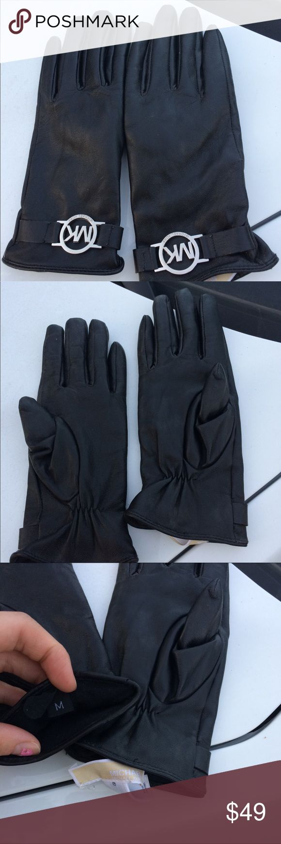 Michael Kors black leather gloves Buttery soft black leather. EUC. Worn once. Silver metal logo charms on outsides. Size M KORS Michael Kors Accessories Gloves & Mittens