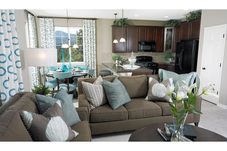 Teal Pillows Contrast With Dark Taupe Sofas Accents In The Kitchen And Eating Area Unite This Open Floorplan Pondero