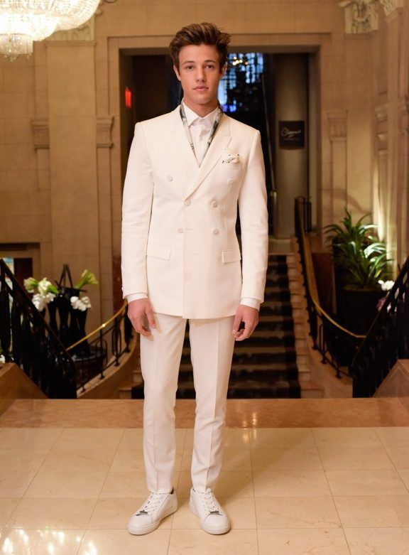Cameron Dallas wears a white tuxedo from Topman to the 2016 Met Gala.