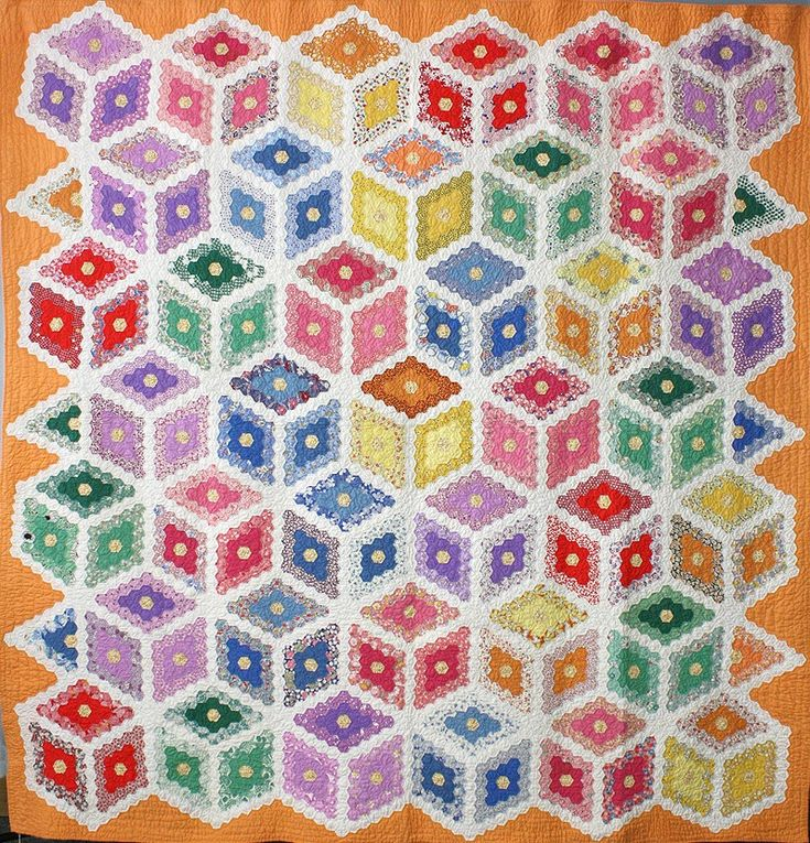 Grandmother's Flower Garden Variation at the La Conner Quilt  Textile Museum until June 2013.  This quilt features hexagons formed into diamond blocks that are arranged in a Tumbling Block setting.