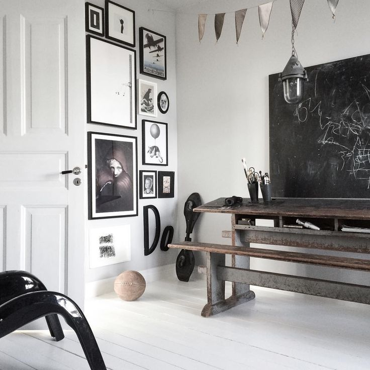 Amazing living room with painted wooden floors, light gray walls, black board  and photowall with framed poster from printler.com, the marketplace for photo art. Interior design by bohemdeluxe at instagram.